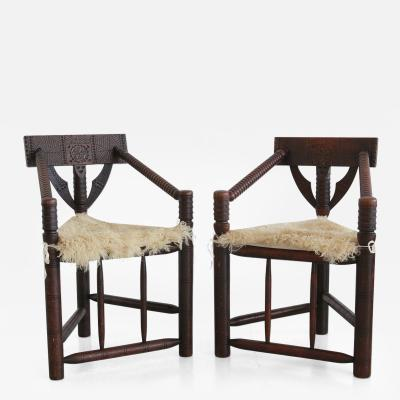 Pair of Carved African Monk Chairs