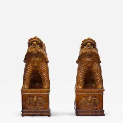 Pair of Chinese Umber Glazed Porcelain Foo Lions