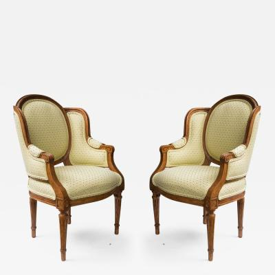 Pair of Diminutive Louis XVI Beechwood Wing Chairs