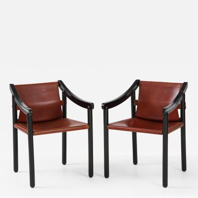 Pair of Early 20th Century Ebonized Wood and Leather Armchairs