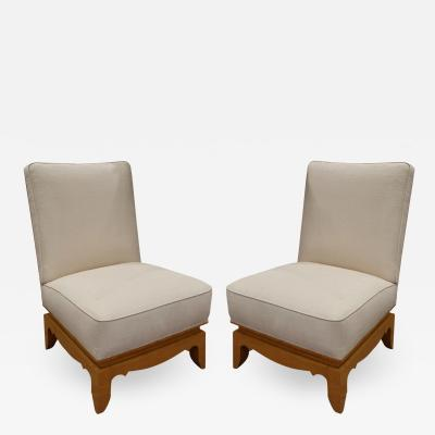 Pair of Elegant French Slipper Chairs with Sculpted Bases 1950s