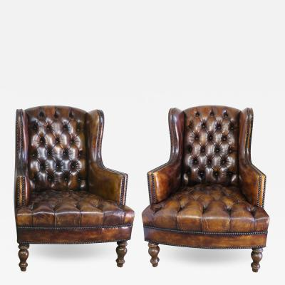Pair of English Leather Tufted Armchairs