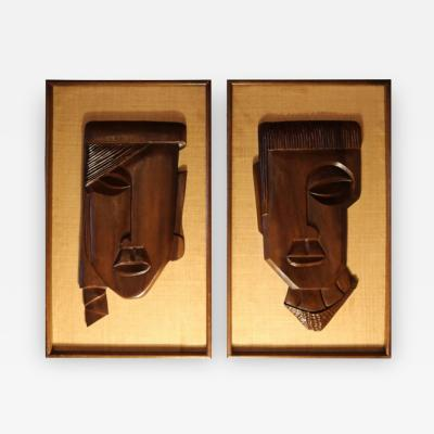 Pair of Framed Carved Brown Rosewood African Faces
