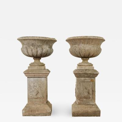 Pair of French 19th Century Cast Stone Urns on Pedestals