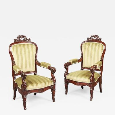 Pair of French Carved Mahogany Armchairs 19th Century