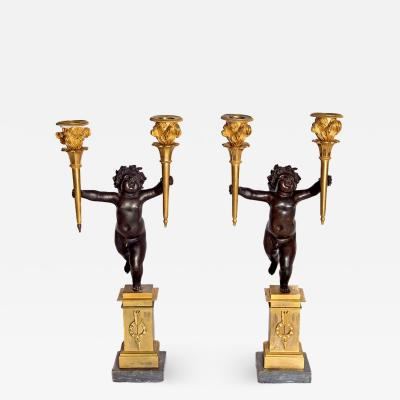 Pair of French Charles X Patinated Bronze and Gilt Figurative Candelabras