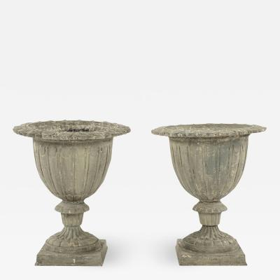 Pair of French Gray Painted Cast Iron Garden Urns