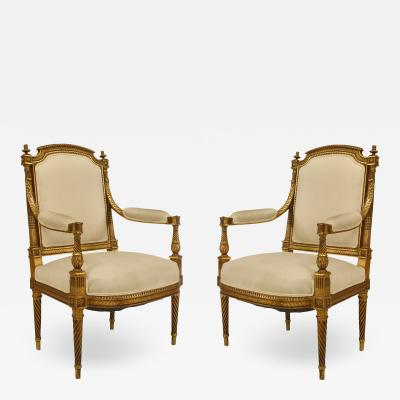 Pair of French Louis XVI Gilt Arm Chairs