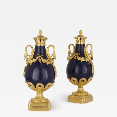 Pair of French Neoclassical style lapis and gilt bronze vases