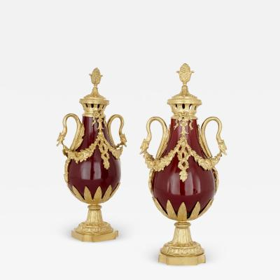 Pair of French Neoclassical style red t le and gilt bronze vases