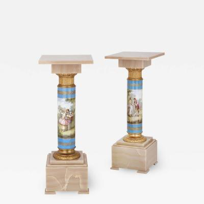 Pair of French Rococo style onyx and porcelain pedestals