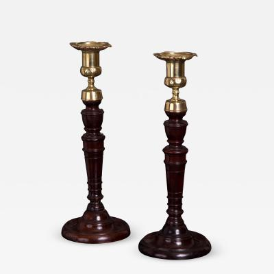 Pair of George III Mahogany and Cast Brass Candlesticks