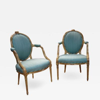 Pair of George III period giltwood salon chairs in the manner of Linnell