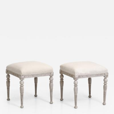 Pair of Gustavian style stools richly carved