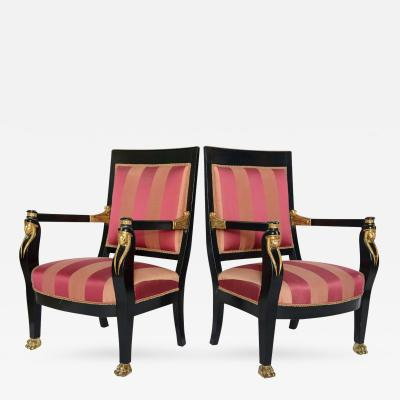 Pair of Italian Neoclassic Ebonized and Parcel Gilt Armchairs