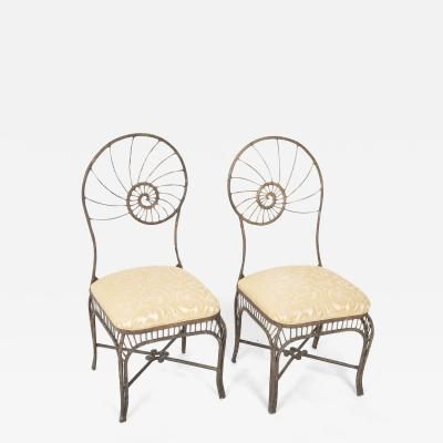 Pair of Italian metal chairs with facing nautilus shell design backs