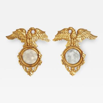 Pair of Italian neoclassic Giltwood Mirrors with Eagles Wings Outstretched