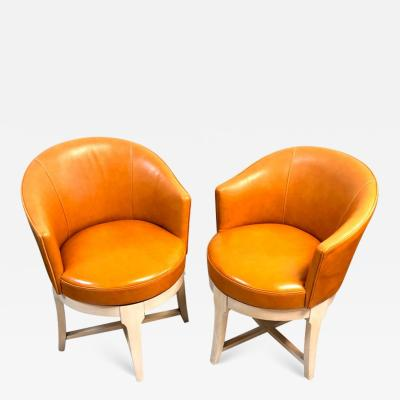 Pair of Leather Swivel Armchairs