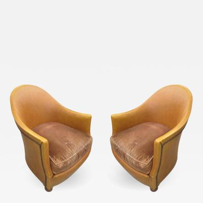 Pair of Leather Upholstered Tub Chairs