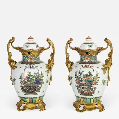 Pair of Louis XVI Style Chinese Porcelain Urns with Ormolu Mounts