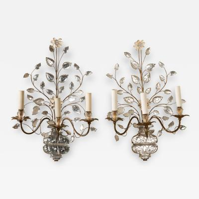 Pair of Maison Bagues gilt metal and glass sconces