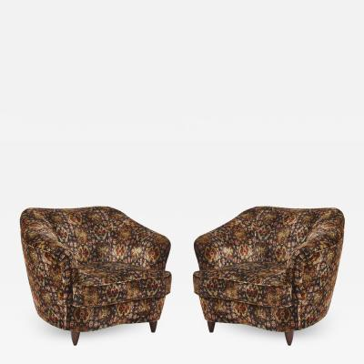 Pair of Mid Century Italian club chairs in the manner of Gio Ponti