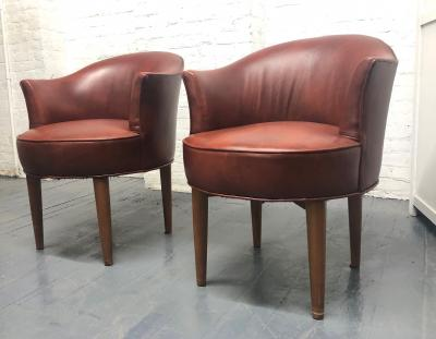 Pair of Mid Century Modern Leather Swivel Chairs
