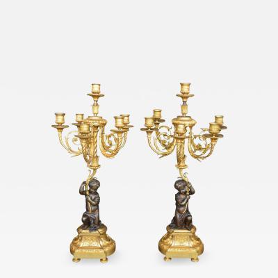 Pair of Putti Bronze Candelabras