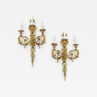 Pair of Rare Louis XV Style Gilt Bronze Three Light Wall sconces