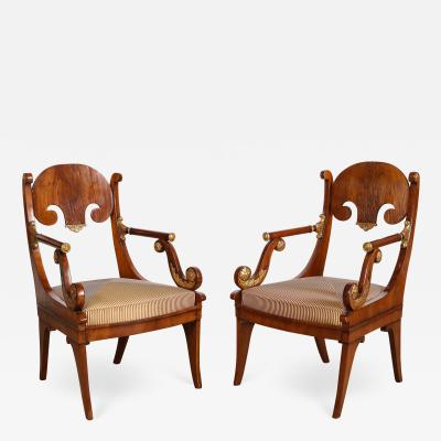 Pair of Russian Neoclassical Parcel Gilt Mahogany Armchairs