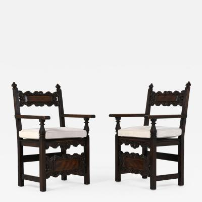 Pair of Spanish style Oak Wood Arm Chairs
