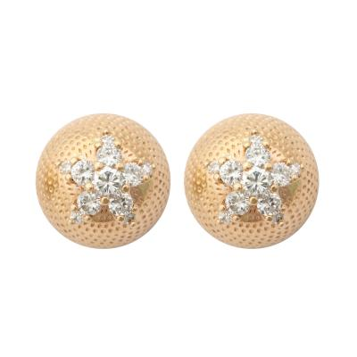 Pair of Stippled 18 kt Gold and Diamond Studs