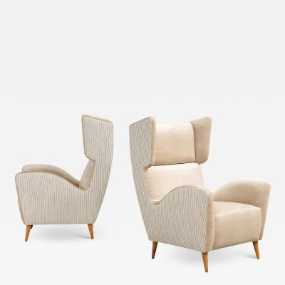 Pair of Stylized Wing Chairs