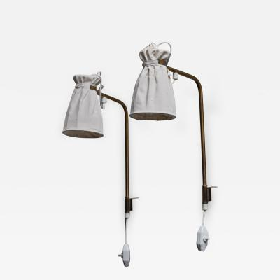 Pair of Swedish Modern brass and fabric wall lamps