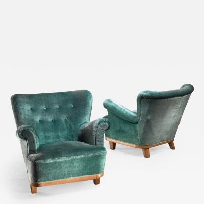 Pair of Swedish easy chairs 1940s