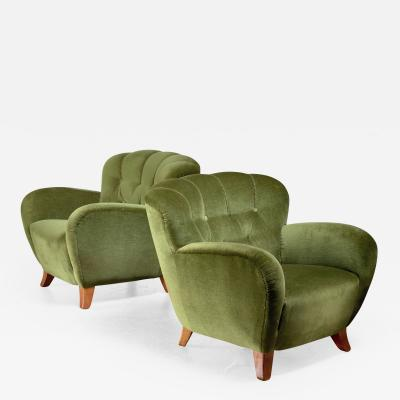 Pair of Swedish green easy chairs 1940s