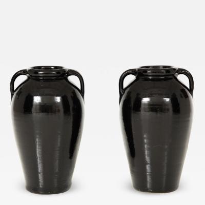Pair of Tall Black Glazed Stone Pottery Vases