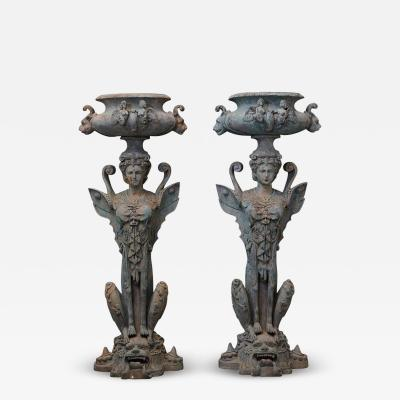 Pair of Tall Patinated Cast Iron Planters Showing Mythical Creatures Chimeres