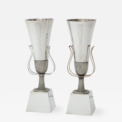 Pair of Tommy Parzinger silverplated urn lamps