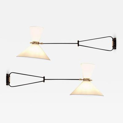 Pair of adjustable and foldable wall lights by Arlus France circa 1950