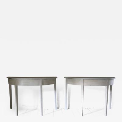 Pair of antique demi lune tables