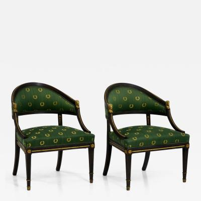 Pair of black painted armchairs circa 100 years old