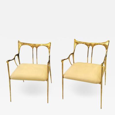Pair of bronze armchairs