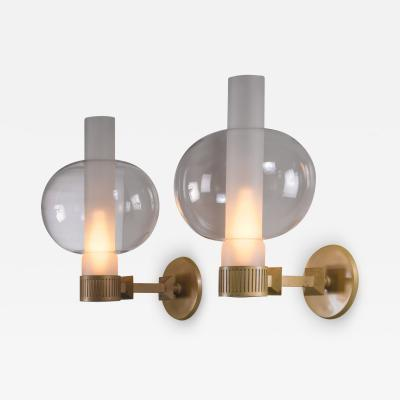 Pair of bronzed metal and glass wall lamps