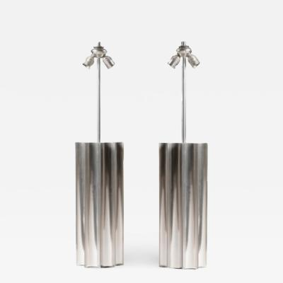 Pair of large 1970s stainless steel lamps