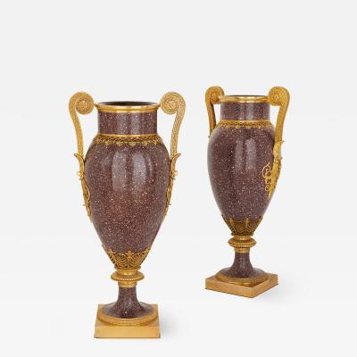 Pair of large French porphyry and gilt bronze vases