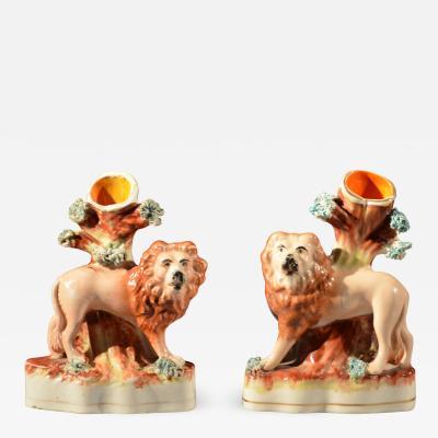 Pair of lion spill vases