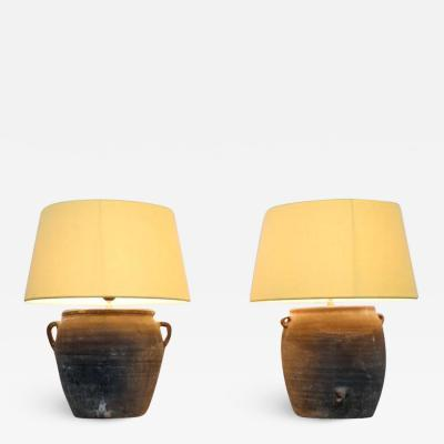 Pair of old pottery lamps