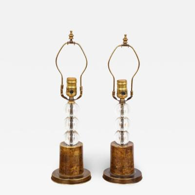 Pair of orb lamps on brass plinth base