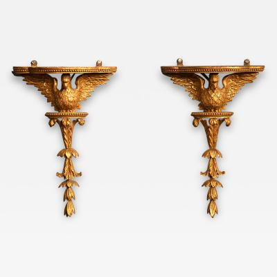 Pair of period Neoclassical giltwood eagle wall brackets